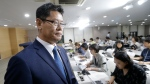 South Korean Unification Minister Kim Yeon-chul leaves after a press conference at the government complex in Seoul, South Korea, Wednesday, June 19, 2019. South Korea says it plans to send 50,000 tons of rice to North Korea through the World Food Program in its second aid package announced over the past month as it looks to help with the North's food shortages and improve bilateral relations. (AP Photo/Ahn Young-joon)