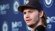 FILE - In this April 22, 2019, file photo, Winnipeg Jets' Jacob Trouba speaks to the media at their closing press conference after losing in the first round of the NHL playoffs, in Winnipeg, Manitoba.  (John Woods/The Canadian Press via AP, File)