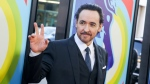 "FILE - In this June 2, 2015 file photo, actor John Cusack arrives at the premiere of ""Love & Mercy"" in Beverly Hills, Calif. Cusack has apologized for tweeting an anti-Semitic cartoon and quotation after initially defending the post, then deleting it. (Photo by Rich Fury/Invision/AP, File)"
