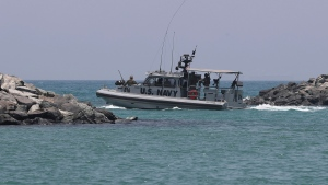"A U.S. Navy patrol boat carrying journalists to see damaged oil tankers leaves a U.S. Navy 5th Fleet base near Fujairah, United Arab Emirates, Wednesday, June 19, 2019. The limpet mines used to attack a Japanese-owned oil tanker near the Strait of Hormuz bore ""a striking resemblance"" to similar mines displayed by Iran, a U.S. Navy explosives expert said Wednesday. Iran has denied being involved. (AP Photo/Kamran Jebreili)"