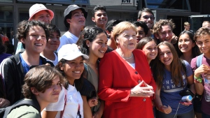 German Chancellor Angela Merkel (CDU, M) stands together with a group of pupils during her visit to Goslar, Wednesday, June 19, 2019. In the afternoon the head of government wanted to discuss with pupils in the historic imperial palace. (Swen Pfoertner/dpa via AP)