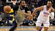 In this March 23, 2019, file photo, Memphis Grizzlies guard Mike Conley (11) handles the ball against Minnesota Timberwolves guard Josh Okogie (20) in the first half of an NBA basketball game, in Memphis, Tenn. A person with knowledge of the decision says the Memphis Grizzlies have traded veteran point guard Mike Conley, who has played the most games in franchise history, to the Utah Jazz. The person says the Grizzlies swapped Conley for Jae Crowder, Kyle Korver and Grayson Allen. The person spoke to The Associated Press Wednesday, June 19, 2019, on condition of anonymity because neither Memphis nor Utah has announced the trade.(AP Photo/Brandon Dill, File)
