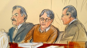 In this Tuesday, May 7, 2019 file courtroom drawing, defendant Keith Raniere, center, leader of the secretive group NXIVM, is seated between his attorneys Paul DerOhannesian, left, and Marc Agnifilo during the first day of his sex trafficking trial.  After weeks of relentlessly lurid testimony, federal prosecutors  have wrapped up their case against Raniere, a former self-improvement guru accused of sex trafficking. Both prosecutors and defense lawyers told the judge Friday, June 14  they were finished calling witnesses. Closing arguments and jury deliberations will happen next week. (Elizabeth Williams via AP, File)