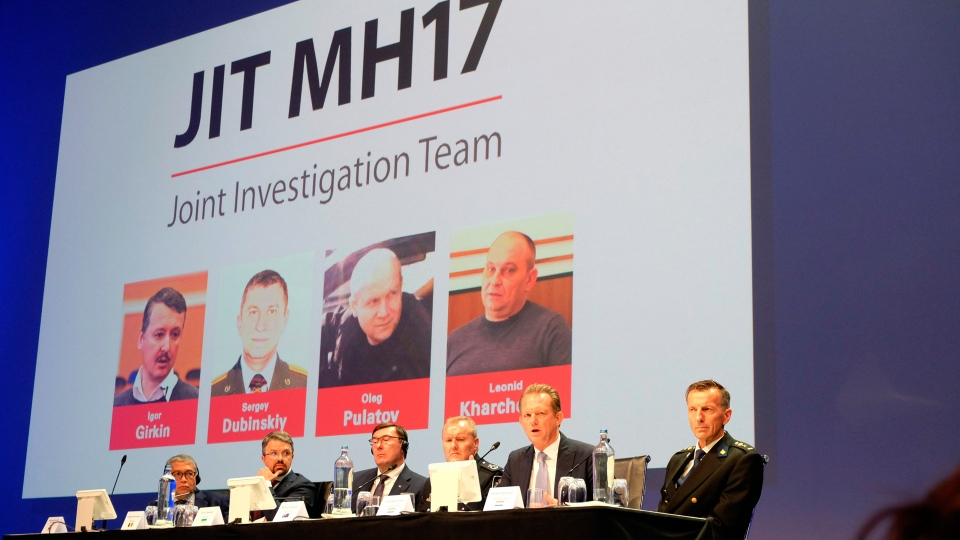 Officials from the Joint Investigation Team probing the downing of Malaysia Airlines Flight 17 in 2014 appear at a press conference in Nieuwegein, Netherlands, on Wednesday, June 19, 2019. The international investigation team charged three Russians and a Ukrainian separatist with the murder of 298 people on board the plane that was shot down over Ukraine. The case is set to start in March 2020. (AP Photo/Mike Corder)