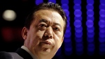 FILE - In this July 4, 2017, file photo, then Interpol President Meng Hongwei delivers his opening address at the Interpol World Congress, in Singapore. A Chinese court says former Interpol President Meng has confessed to accepting more than $2 million in bribes and expressed regret for his crime. (AP Photo/Wong Maye-E, File)