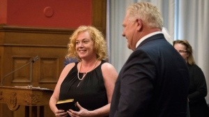 Lisa MacLeod stands next to Ontario Premier Doug Ford after being named Ontario's Minister of Tourism, Culture and Sport at Queen's Park in Toronto on Thursday, June 20, 2019. THE CANADIAN PRESS/ Tijana Martin