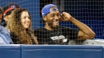 Toronto Raptors basketball player Kawhi Leonard and his girlfriend Kishele Shipley watch the Toronto Blue Jays play the Los Angeles Angels during MLB baseball action in Toronto, Thursday June 20, 2019. THE CANADIAN PRESS/Mark Blinch
