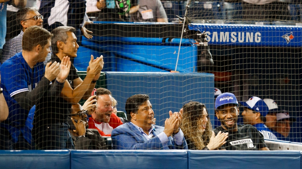 Toronto Raptors basketball player Kawhi Leonard gets a standing ovation with his girlfriend Kishele Shipley as they watch the Toronto Blue Jays play the Los Angeles Angels during MLB baseball action in Toronto, Thursday June 20, 2019. THE CANADIAN PRESS/Mark Blinch