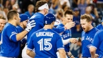 Toronto Blue Jays' Billy McKinney, right, celebrates with teammates after he hit a walk-off home run against the Los Angeles Angels during the tenth inning of MLB baseball action in Toronto, Thursday June 20, 2019. THE CANADIAN PRESS/Mark Blinch