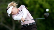 Brooke Henderson, of Canada, hits off the 10th tee during the first round of the KPMG Women's PGA Championship golf tournament, Thursday, June 20, 2019, in Chaska, Minn. (AP Photo/Charlie Neibergall)