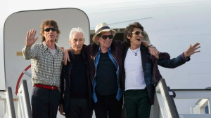 In this March 24, 2016 file photo, members of The Rolling Stones, from left, Mick Jagger, Charlie Watts, Keith Richards and Ron Wood pose for photos from the plane that brought them to Cuba at Jose Marti international airport in Havana, Cuba. (AP Photo/Ramon Espinosa File)