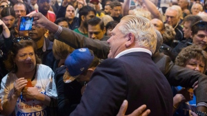 Ontario Premier Doug Ford poses for a selfie with a supporter after speaking at Ford Fest in Vaughan, Ontario, on Saturday September 22, 2018. Event organizers say the annual barbecue is expected to be bigger than ever with Doug Ford as premier. THE CANADIAN PRESS/Chris Young