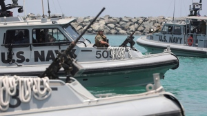 """U.S. Navy patrol boats carrying journalists to see damaged oil tankers leaves a U.S. Navy 5th Fleet base near Fujairah, United Arab Emirates, Wednesday, June 19, 2019. The limpet mines used to attack a Japanese-owned oil tanker near the Strait of Hormuz bore """"a striking resemblance"""" to similar mines displayed by Iran, a U.S. Navy explosives expert said Wednesday. Iran has denied being involved. (AP Photo/Kamran Jebreili)"""