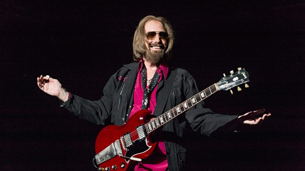 "In a Sunday, Sept. 17, 2017 file photo, Tom Petty and the Heartbreakers perform at KAABOO 2017 at the Del Mar Racetrack and Fairgrounds, in San Diego, Calif.  A California real estate agent and self-proclaimed ""super fan"" says he's extended an offer to buy the Florida home of Petty. Kevin Beauchamp tells The Gainesville Sun he quickly made an offer of $175,000 for the nearly 1,200-square-foot (111-sq. meter) home after seeing the home's current owner Brandy Clark mention on a Petty Facebook fan club that she might sell it. (Photo by Amy Harris/Invision/AP, File)"