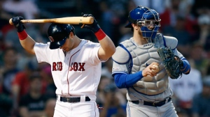 Boston Red Sox's Andrew Benintendi, left, reacts next to Toronto Blue Jays' Luke Maile after striking out swinging during the ninth inning of a baseball game in Boston, Saturday, June 22, 2019. (AP Photo/Michael Dwyer)