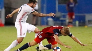 FC Dallas midfielder Paxton Pomykal (19) goes to the ground after a push by Toronto FC midfielder Alejandro Pozuelo (10) during the second half of an MLS soccer match Saturday, June 22, 2019, in Frisco, Texas. (Stewart F. House/The Dallas Morning News via AP)