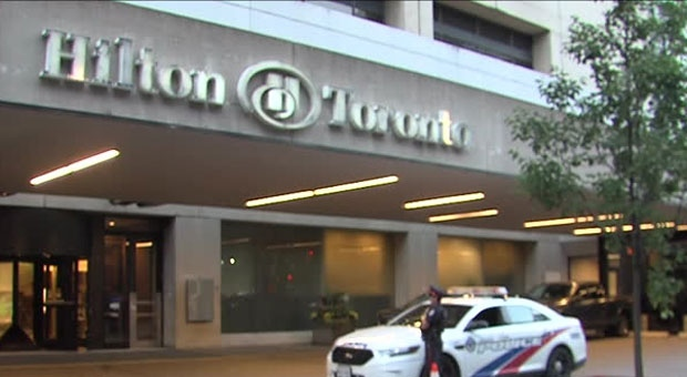 Police are searching for at least two suspects after shots were fired outside a downtown hotel.