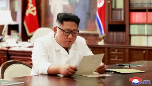 """In this undated photo provided on Sunday, June 23, 2019, by the North Korean government, North Korean leader Kim Jong Un reads a letter from U.S. President Donald Trump. Independent journalists were not given access to cover the event depicted in this image distributed by the North Korean government. The content of this image is as provided and cannot be independently verified. Korean language watermark on image as provided by source reads: """"KCNA"""" which is the abbreviation for Korean Central News Agency. (Korean Central News Agency/Korea News Service via AP)"""