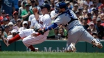 Boston Red Sox's Brock Holt, left, is tagged out by Toronto Blue Jays' Danny Jansen, right, as he attempts to score on a single by Red Sox's Jackie Bradley Jr. in the second inning of a baseball game in Boston, Sunday, June 23, 2019. (AP Photo/Steven Senne)