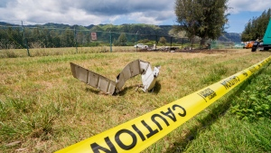 A Beechcraft King Air twin-engine plane crashed Friday evening killing multiple people and leaving wreckage near a chain link fence surrounding Dillingham Airfield seen Saturday, June 22, 2019, in Mokuleia, Hawaii. No one aboard the skydiving plane survived the crash. The flight was operated by the Oahu Parachute Center skydiving company. (Dennis Oda/Honolulu Star-Advertiser via AP)