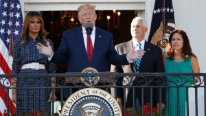 President Donald Trump, with first lady Melania Trump, and Vice President Mike Pence and his wife Karen, speaks from the Truman Balcony of the White House during the annual Congressional Picnic on the South Lawn, Friday June 21, 2019, in Washington. (AP Photo/Jacquelyn Martin)
