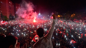 Ekrem Imamoglu, the candidate of the secular opposition Republican People's Party, CHP, waves to supporters at a celebratory rally in Istanbul, late Sunday, June 23, 2019. Tens of thousands of people attended an election night celebration after a repeated vote in Istanbul made Imamoglu the mayor-elect of Turkey's largest city. (Onur Gunay/Imamoglu Media team via AP)