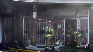 Firefighters respond to the scene of a fire at a strip plaza at Krosno Boulevard and Liverpool Road in Pickering.