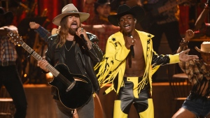 "Billy Ray Cyrus, left, and Lil Nas X perform ""Old Town Road"" at the BET Awards on Sunday, June 23, 2019, at the Microsoft Theater in Los Angeles. (Photo by Chris Pizzello/Invision/AP)"