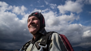 Henry Martens, 95, smiles after performing a tandem skydive as part of a fundraiser for a new seniors care home and hospital, in Abbotsford, B.C., on Saturday, June 8, 2019. THE CANADIAN PRESS/Darryl Dyck