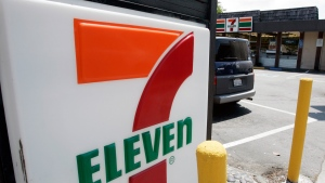 In this July 1, 2008 file photo, a 7-Eleven is shown in Palo Alto, Calif. The convenience-store chain is launching a service that lets customers order everything from its trademark frozen drink to a battery charger and have it delivered to a public place like a park or a beach. (AP Photo/Paul Sakuma, File)