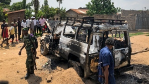 Congolese security forces attend the scene after the vehicle of a health ministry Ebola response team was attacked in Beni, northeastern Congo Monday, June 24, 2019. (AP Photo/Al-hadji Kudra Maliro)