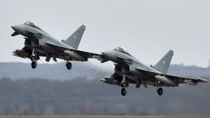 In this March 21, 2016 file photo, two Eurofighter jets perform at the German Air Force Base in Noervenich, western Germany. Two German Eurofighter military planes crashed today near the city of Jabel in eastern Germany. (AP Photo/Martin Meissner)