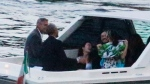 Former U.S. President Barack Obama, center, takes a boat ride with relatives and actor George Clooney while on vacation on Como Lake, Cernobbio, northern Italy, Sunday, June 23, 2019. (Matteo Bazzi/ANSA via AP)