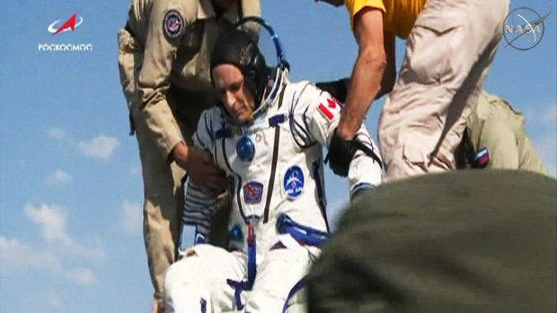 Astronauts float back to earth after 6 months on space station
