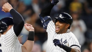 New York Yankees' Aaron Hicks, right, celebrates with designated hitter Luke Voit, after they scored on Hicks' three-run home run during the fifth inning of a baseball game against the Toronto Blue Jays, Monday, June 24, 2019, in New York. (AP Photo/Kathy Willens)