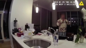 "This Jan. 29, 2019, image made from police body cam video provided by the Chicago Police Department purports to show Jussie Smollett, with a white rope wrapped around his neck, talking with police officers in his apartment in Chicago. Chicago police on Monday, June 24, released hundreds of files from the investigation into Smollett's claim he was attacked by two men, including releasing the video footage for the first time of the ""Empire"" actor wearing the thin white rope wrapped around his neck that he told detectives was a noose. The footage from the Chicago police blurred out Smollett's face because, police explained, he was considered a victim at that point. (Chicago Police Department via AP)"