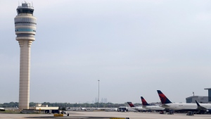 In this Monday, May 9, 2016 photo, aircraft sit at their gates at Hartsfield-Jackson International Airport, in Atlanta. (AP Photo/Mike Stewart)