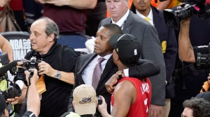 This Thursday, June 13, 2019, file photo, Toronto Raptors general manager Masai Ujiri, center left, walks with guard Kyle Lowry after the Raptors defeated the Golden State Warriors in Game 6 of the NBA Finals in Oakland, Calif. (AP Photo/Tony Avelar, File)