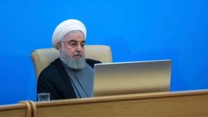 "In this photo released by the official website of the office of the Iranian Presidency, President Hassan Rouhani attends a meeting with the Health Ministry officials in Tehran, Iran, Tuesday, June 25, 2019. Rouhani said the new U.S. sanctions targeting the Islamic Republic's supreme leader and others are ""outrageous and idiotic."" The comments by Hassan Rouhani come a day after the Trump administration sanctioned Supreme Leader Ayatollah Ali Khamenei and his associates. (Iranian Presidency Office via AP)"