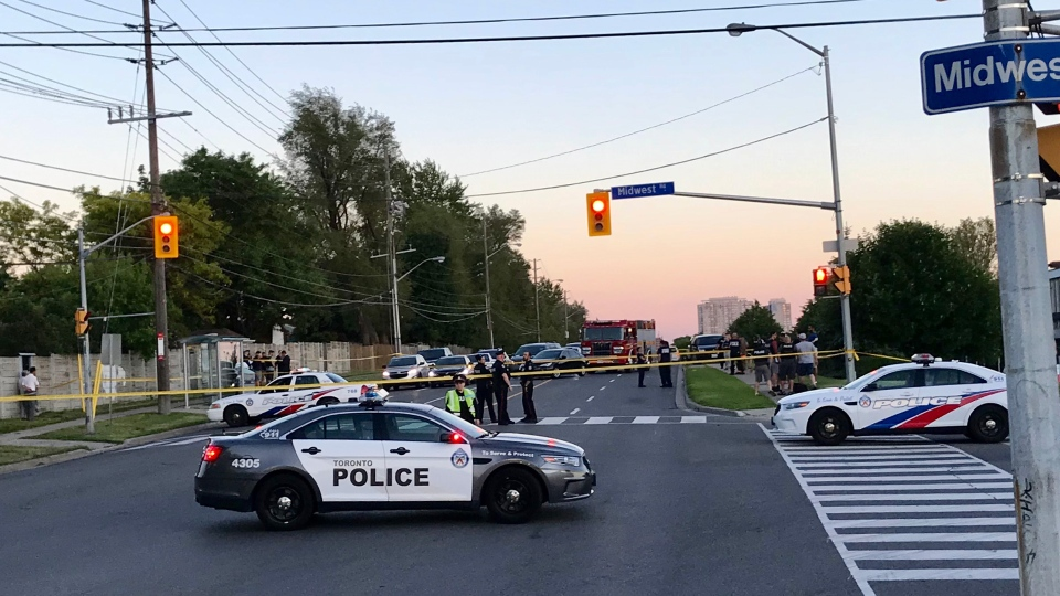 Police vehicles are pictured at the scene of a shooting near Midland Avenue and Midwest Road Tuesday June 25, 2019. (Jason Hiscox)