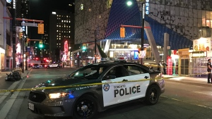 Police investigate a stabbing near Yonge and Gould streets Tuesday June 25, 2019. (Mike Nguyen /CP24)