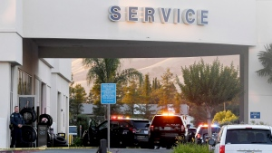 Police investigate at the scene of a shooting at the Morgan Hill Ford Store in Morgan Hill, Calif., Tuesday, June 25, 2019. Police say at least three people were shot including the suspect in what may be a workplace confrontation. (AP Photo/Nic Coury)