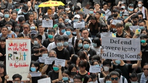 Protesters gather near the U.S. Consulate as they stage a protest in Hong Kong, Wednesday, June 26, 2019. Hong Kong activists opposed to contentious extradition legislation on Wednesday called on leaders of the U.S., the European Union and others to raise the issue with Chinese President Xi Jinping at this week's G-20 summit in Japan. (AP Photo/Kin Cheung)