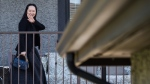 Huawei chief financial officer Meng Wanzhou, waves as she returns home after attending a court appearance in Vancouver, on Wednesday May 8, 2019. Defence lawyers for a senior Huawei executive have asked Canada's foreign affairs minister to stop the extradition process against their client, saying the request made by the United States was for political purposes, not legitimate law enforcement reasons. THE CANADIAN PRESS/Darryl Dyck