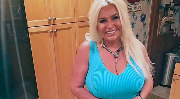 "This 2017 photo provided by Mona Wood-Sword shows Beth Chapman in Honolulu. The wife of reality TV bounty hunter Duane ""Dog"" Chapman is in a medically induced coma, a report said. Chapman is in the intensive care unit of Queen's Medical Center in Honolulu, The Honolulu Star-Advertiser reported Sunday, June 23, 2019. (Mona Wood-Sword via AP)"