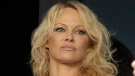 US actress Pamela Anderson applauds at the start of the League One soccer match between Marseille and Caen at the Velodrome stadium, in Marseille, southern France, Sunday, Oct. 7, 2018. (AP Photo/Claude Paris)