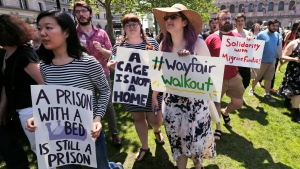 Employees of Wayfair march to Copley Square in protest prior to their rally in Boston, Wednesday, June 26, 2019. Employees at online home furnishings retailer Wayfair walked out of work to protest the company's decision to sell $200,000 worth of furniture to a government contractor that runs a detention center for migrant children in Texas. (AP Photo/Charles Krupa)