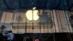 In this Saturday June 15, 2019 photo customers leave an Apple store on the 3rd Street Promenade in Santa Monica, Calif. (AP Photo/Richard Vogel)