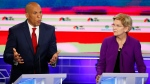 Democratic presidential candidate Sen. Cory Booker, D-N.J., speaks during a Democratic primary debate hosted by NBC News at the Adrienne Arsht Center for the Performing Art, Wednesday, June 26, 2019, in Miami, as Sen. Elizabeth Warren, D-Mass., listens. (AP Photo/Wilfredo Lee)