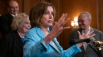 Speaker of the House Nancy Pelosi, D-Calif., holds an event before a House vote on the SAFE Act (Securing America's Federal Elections Act) which aims to protect the integrity of elections from outside interference, at the Capitol in Washington, Wednesday, June 26, 2019. (AP Photo/J. Scott Applewhite)